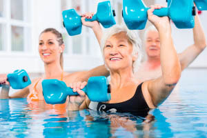 Seniors Exercising in a Pool
